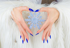 The heart of the Christmas for your Christmas and New Year parti. Nails decorated with blue color and bright stars to celebrate Christmas and the last of the Royalty Free Stock Photography