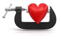 Heart in clamp (clipping path included) Royalty Free Stock Photography