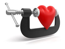 Heart in clamp (clipping path included) Stock Photo