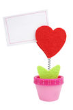 Heart clip with blank paper note. Red woolen heart clip growing from flower pot with blank paper note isolated on white Royalty Free Stock Image