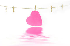 Heart on a clothes line Stock Image