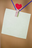 Heart clothes peg holding note. With blank copy space stock image