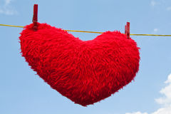 Heart on a clothesline Stock Image