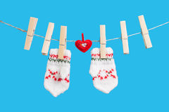 Heart on clothesline with clothespins, two mittens Royalty Free Stock Photography