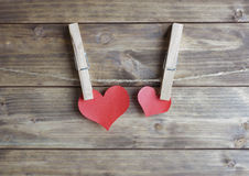 Heart with clothespin hanging on a rope Royalty Free Stock Images