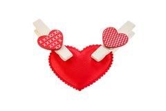 Heart on clothespins Stock Photos