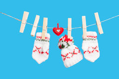 Heart, clothespins, two gloves and hat Stock Images