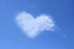 Heart cloud. Heart shaped cloud in blue sky Royalty Free Stock Images