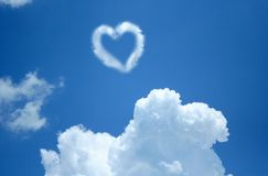 Heart Cloud. There is a heart shaped cloud in the center of the sky leaving room for text on either side Royalty Free Stock Photography