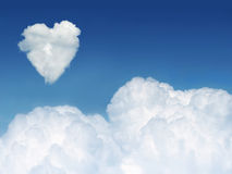Heart cloud. Cloud nine concept - a heart shaped cloud formation against clear blue sky, with space for copy Stock Images