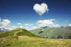 Heart from cloud in the blue sky. Caucasus mountains. Abkhazia. Heart from cloud in the blue sky Royalty Free Stock Photography
