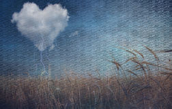 Heart cloud over field grunge textured Stock Photography