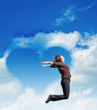 Heart of clouds and girl Stock Photo