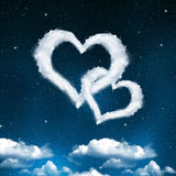 Heart from clouds on night sky. Valentines night Stock Image