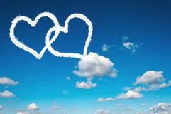 Heart clouds. Shape on the clear blue sky Royalty Free Stock Image