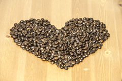 Heart from coffe beans on the table Royalty Free Stock Images