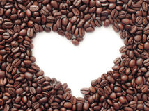 Heart of the coffee. Isolated photo set the coffee beans with a white heart in the middle. Reflects the love to coffee Stock Image