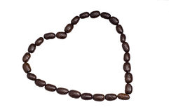 Heart Coffee. Heart shape made of black roasted coffee beans isolated on white with work path. Concept picture for coffee being good for heart Royalty Free Stock Photo