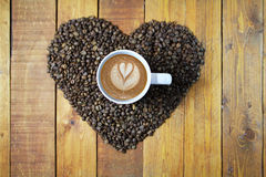 Heart of Coffee. A heart of coffee beans with cup of espresso Stock Photography