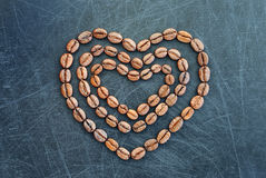 Heart of coffee as a symbol of love. I love coffee beans heart shape background. royalty free stock photography