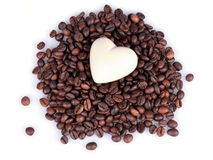 Heart on coffee beans. White heart on coffe beans Stock Image