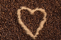 Heart in coffee beans Stock Image