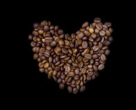 Heart of the coffee beans. On a blsck background Royalty Free Stock Photo