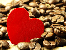 Heart and Coffee beans close-up on wooden, oak table. Royalty Free Stock Photography