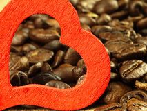 Heart and Coffee beans close-up on wooden, oak table. Stock Photos
