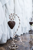 Heart coffee beans on holder. Heart of coffee beans hanging on a striped holder Stock Photography