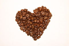 Heart of coffee beans isolate. Heart of coffee beans on a white background royalty free stock photography