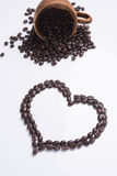 Heart from coffee beans isolated on a white background.  Stock Images