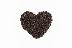 Heart from coffee beans isolated on a white background. Heart from coffee beans isolated on  white background Royalty Free Stock Image