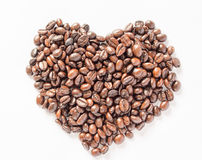 Heart coffee beans isolated white background. Heart coffee beans isolated on  white background Royalty Free Stock Images