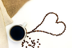 Heart of the coffee beans. With pullover on white background Royalty Free Stock Photo