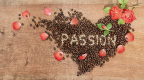 A heart of coffee beans and red roses. Stock Images