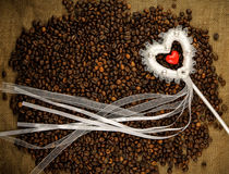 Heart with coffee beans on the sackcloth Stock Images