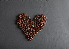 Heart of coffee beans. On shate board Royalty Free Stock Images