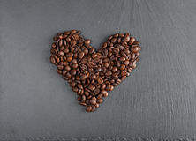 Heart of coffee beans. On shate board Stock Image