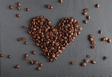 Heart of coffee beans. On shate board Royalty Free Stock Image