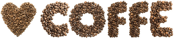 Heart of coffee beans are spinning on the table.  Royalty Free Stock Images