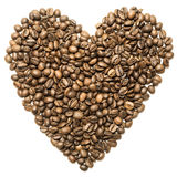 Heart of coffee beans are spinning on the table.  Stock Photos