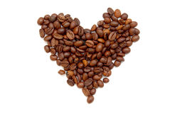 Heart of coffee beans. On white background stock images