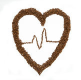 Heart of coffee beans on white background. Royalty Free Stock Image