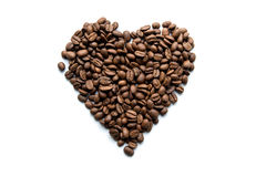 Heart of coffee beans on an white background Royalty Free Stock Images