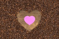Heart of coffee beans on a wooden surface. Coffee beans in the shape of heart on a wooden background with place for text. Postcard, blank, template for St Stock Photos