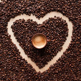 Heart coffee frame with espresso. Heart coffee frame made of coffee beans on textured table. Top view Stock Photos