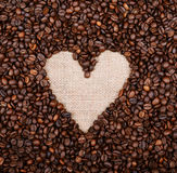 Heart coffee frame made of coffee beans on burlap background Stock Photos