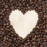 Heart coffee frame made of coffee beans on vintage paper. Stock Photography