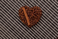 Heart coffee frame made of coffee beans on wood texture, cinnamon Royalty Free Stock Photography